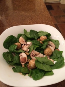 Spinach salad with walnut-encrusted goat cheese